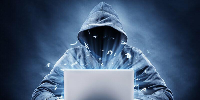 Hooded man as hacker