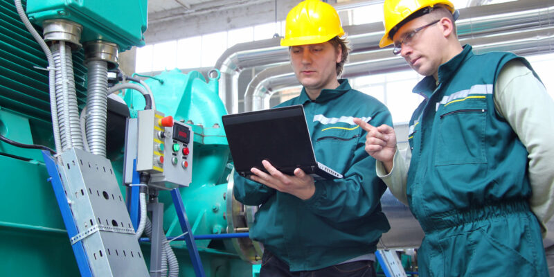 Industrial workers with laptop, teamwork