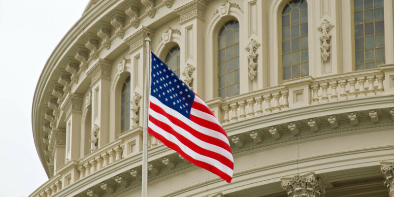 United States Capitol Building in Washington DC with American Flag