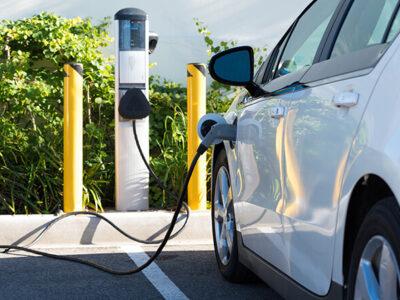 An electric car charging in California