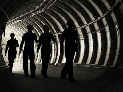 Silhouette of workers in mine