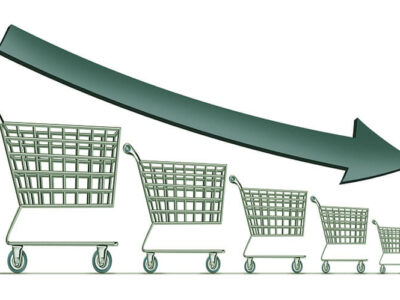 Sales decline symbol as a group of shrinking shopping carts with a dark arrow going down