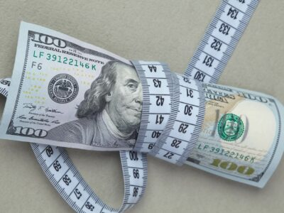 100 dollarы is wrapped in centimeter tape