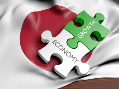 """puzzle of the words """"growth, economy"""" against the background of the Japanese flag"""