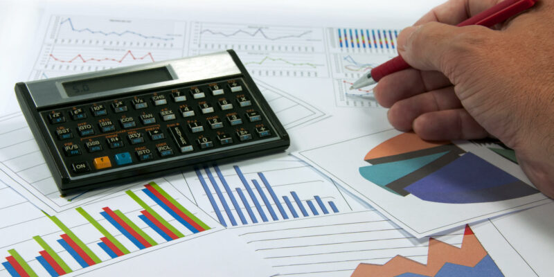 data graphics analysis with calculator and writing hand