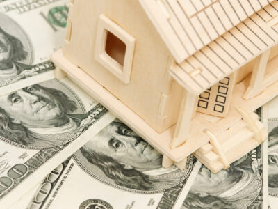 wooden house and cash,focus point on Franklin face