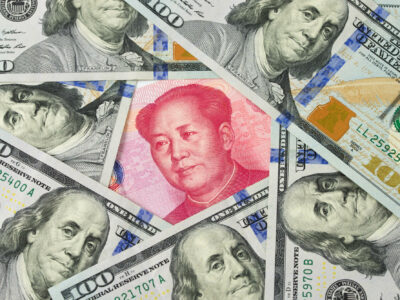 US one hundred dollar bills surrounding against China Yuan note