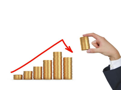 hand puts gold coins in form chart on white background