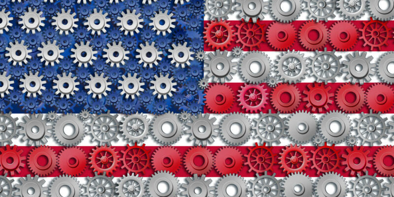 American economy symbol represented by gears and cogs in the shape and color of the flag of the U.S.A. showing industry business and manufacturing working toget