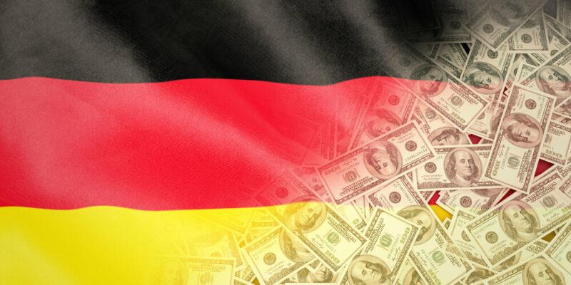 Pile of dollars against digitally generated german national flag